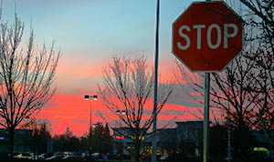 stop-sign-parking-lot-sunset